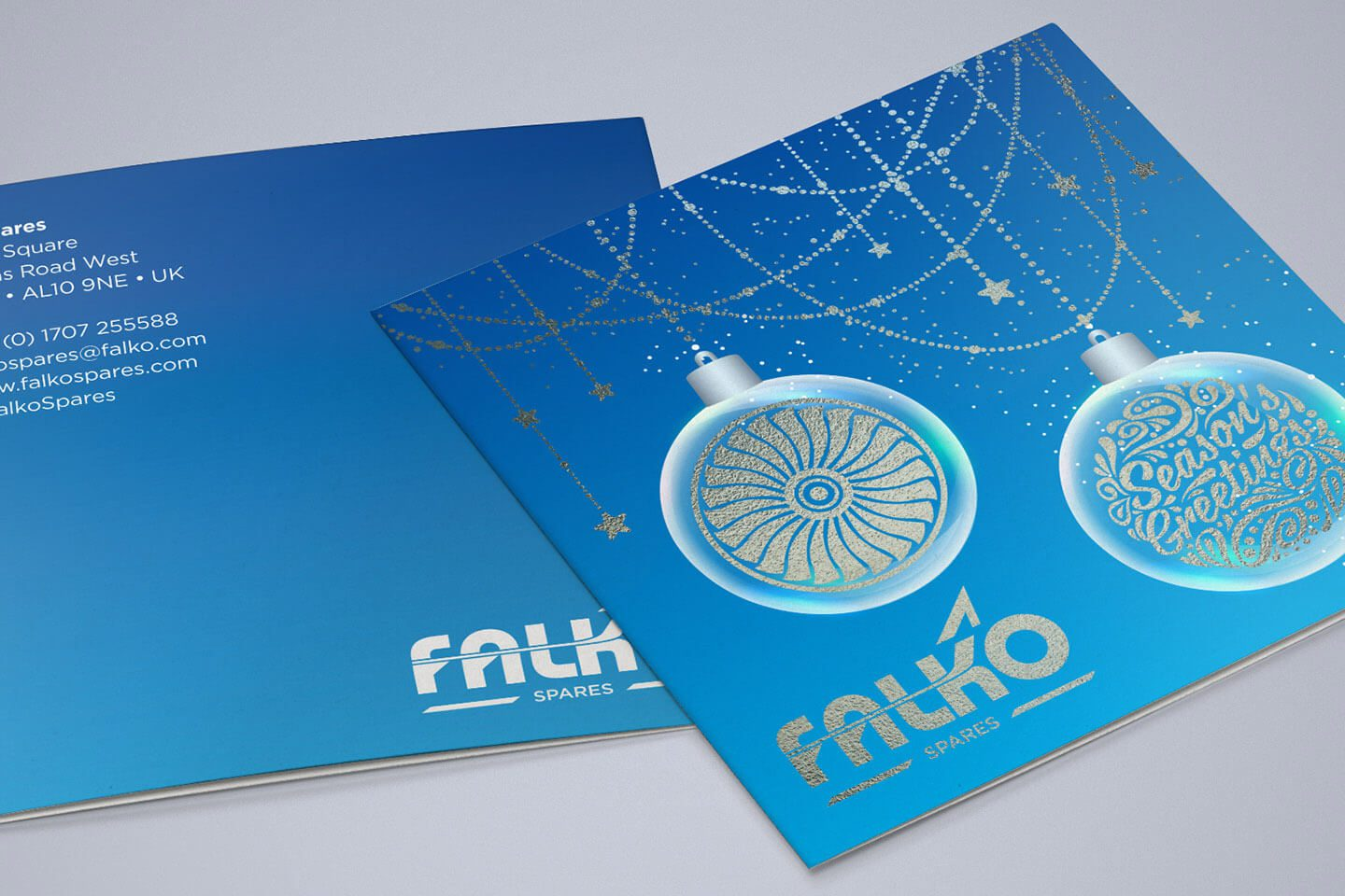 FALKO Case Study Annual Christmas card using white ink and silver foil visual